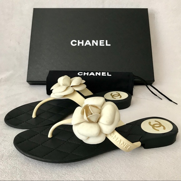 31e2ff506 CHANEL Shoes - Chanel Ivory  Black Camellia Flower Thong Sandals